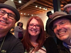 Three Conference Attendees with Hats
